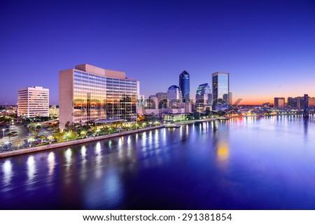 Jacksonville, Florida, USA city skyline on St. Johns River at dawn. - stock photo