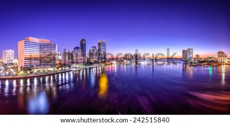 Jacksonville, Florida, USA city skyline panorama on St. Johns River at dawn. - stock photo