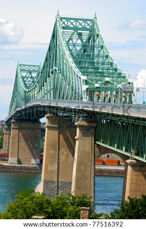 Jacques Cartier bridge crossing Saint Lawrence river in Montreal - stock photo