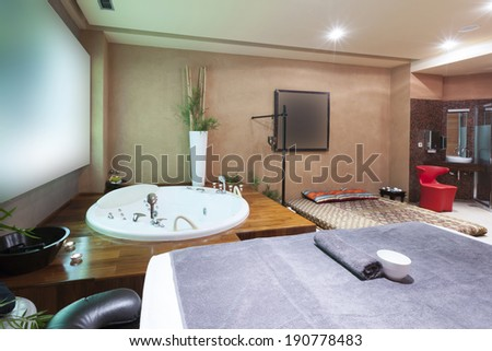 Jacuzzi Bath And Massage Table In Hotel Spa Center