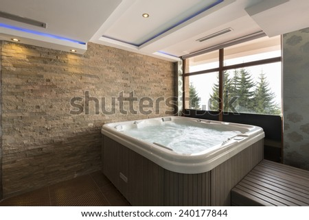 Jacuzzi bath in hotel spa center  - stock photo