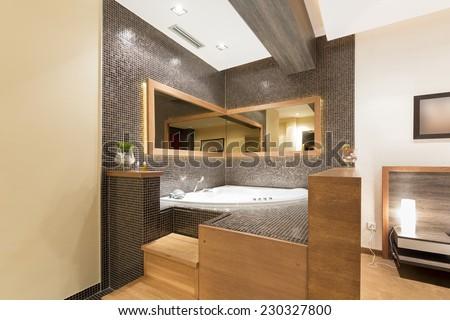 Jacuzzi bath in the bedroom  - stock photo