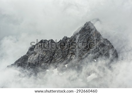 Jade Dragon snow mountain Lijiang city, Yunnan China - stock photo
