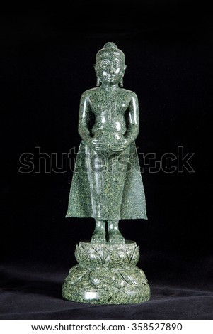 Jade sculpture of buddha isolated on black background. - stock photo