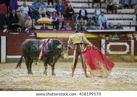 Jaen, SPAIN - October 18, 2008: The Spanish Bullfighter Sebastian Castella during a rainy afternoon bullfighting with the crutch in the Bullring of Jaen, Spain
