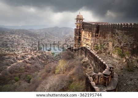 Jaigarh fort tower and high wall on the hill at overcast sky in Jaipur, Rajasthan, India