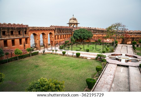 Jaigarh fort wall with beautiful arch and garden on the hill at overcast sky in Jaipur, Rajasthan, India