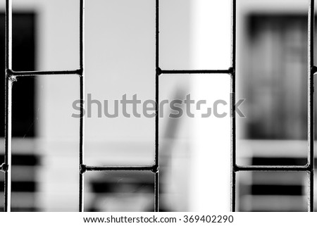Jail or prison cell. Looking for freedom - stock photo