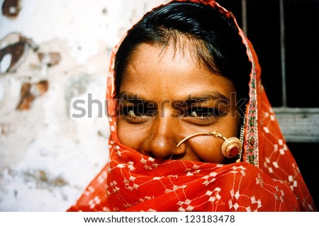 JAIPUR - AUG 25: Rajasthani woman outside here home on August 25 2004 in Jaipur Rajasthan, India.In India, Dalit women experience high rates of sexual violence committed by Indian men of higher caste. - stock photo
