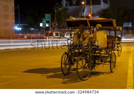 Jaipur, India - August 14, 2015: Resting rickshaw drivers on August 14th in Jaipur, India - stock photo