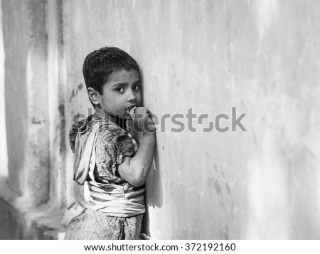 jaipur, India - Circa December 2015 - young homeless girl in india - stock photo