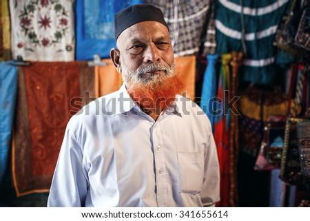 JAIPUR, INDIA - JANUARY 10, 2015: Portrait of  mature bearded seller man on market on January 10, 2015 in Jaipur, India - stock photo