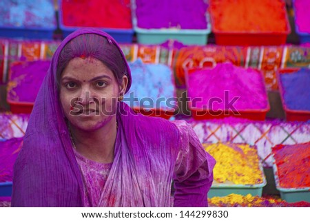 JAIPUR, INDIA - MAR 17:An unidentified woman covered in paint on Holi festival, March 17, 2013, Jaipur.Holi, the festival of colors, marks the arrival of spring, one of the biggest festivals in India - stock photo
