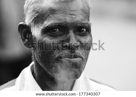 JAIPUR, INDIA � MARCH 4: An unidentified man smoking outside the City Palace on March 4, 2012 ahead of the annual Holi Festival in Jaipur, Rajasthan, Northern India.