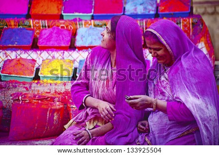 JAIPUR, INDIA - MARCH 17:Lady in violet, covered in paint on Holi festival, March 17, 2013, Jaipur, India. Holi, the festival of colors, the arrival of spring,  one of the biggest festivals in India