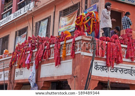 JAIPUR, INDIA - MARCH 25, 2014:  Traders selling headgear and scarves from a rooftop in the Tripolia Bazaar district of the old city