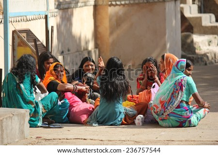 JAIPUR, INDIA - NOV 30: Group pf Indian girls sit on the floor chatting to each other on November 30 2012