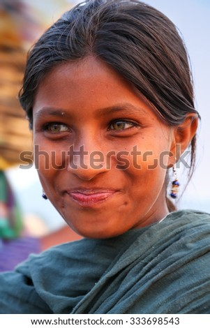 JAIPUR, INDIA - NOVEMBER 13: Unidentified girl (portrait) stands by Man Sagar Lake on November 13, 2014 in Jaipur, India. Jaipur is the capital and largest city of Rajasthan.