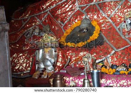 JAIPUR, INDIA - OCT 9, 2017 - Clothing protects images of the god in Galtaji temple, Jaipur, Rajasthan, India