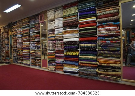 JAIPUR, INDIA - OCT 8, 2017 - Multi colored fabrics for clothing in shop in market of  Jaipur, Rajasthan, India
