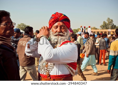 JAISALMER, INDIA - Feb 1: Brave senior man with white beard and mustache going to Mr. Desert beauty competition at the Desert Festival on February 1, 2015. Every winter Jaisalmer takes Desert Festival