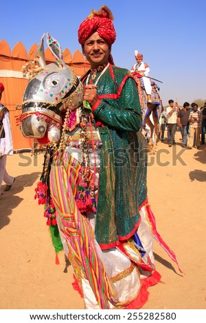 JAISALMER, INDIA - FEBRUARY 16: Unidentified man takes part in Desert Festival on February 16, 2011 in Jaisalmer, India. Main purpose of this Festival is to display colorful culture of Rajasthan - stock photo
