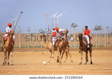 JAISALMER, INDIA - FEBRUARY 16: Unidentified men play camel polo at Desert Festival on February 16, 2011 in Jaisalmer, India. Main purpose of Festival is to display colorful culture of Rajasthan