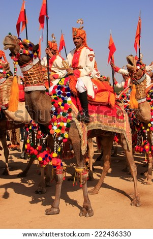 JAISALMER, INDIA-FEBRUARY 16: Unidentified people take part in Desert Festival on February 16, 2011 in Jaisalmer, India. Main purpose of Festival is to display rich and colorful culture of  Rajasthan - stock photo