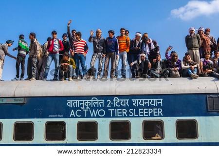 JAISALMER, INDIA - FEBRUARY 23: Unknown Indian men on the train on February 23, 2013 in Jaisalmer, India.The Great Railway Transport System ,Indian railways transport 20 million passengers daily. - stock photo