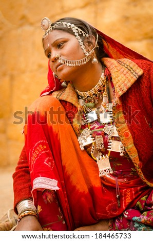 JAISALMER, INDIA - JAN 28: Rajasthani tribal women who dress in vibrant coloured dress and use lots of jewels are found near the Jaisalmer fort on 28 Jan 2014