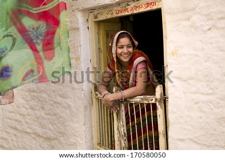 JAISALMER, INDIA - JAN 12: Unidentified Indian woman lives in Jaisalmer Fort in Thar desert on January 12, 2013 in Jaisalmer, India. Jaisalmer Fort is the only livable fort in India.  - stock photo
