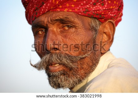 JAISALMER - INDIA - JANUARY 21, 2015: Unidentified old Rajasthani man with traditional turban and moustache on January 21, 2015 in Jaisalmer, India - stock photo