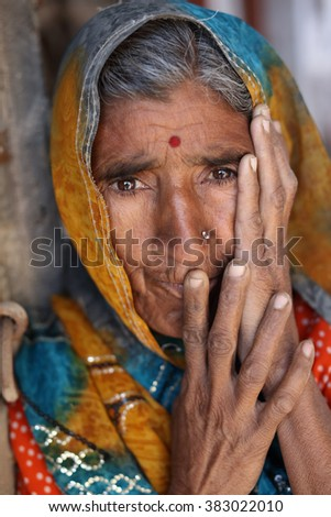 JAISALMER - INDIA - JANUARY 16, 2015: Unidentified old Rajasthani woman with traditional sari on January 16, 2015 in Jaisalmer, India - stock photo