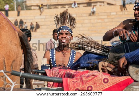 JAISALMER, INDIA - MAR 1: African man in historical tribal costume going to the popular Desert Festival on March 1, 2015 in Rajasthan. Every winter Jaisalmer takes the famous Desert Festival