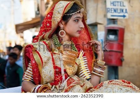 JAISALMER, INDIA - MAR 1: Unidentified girl in indian dress sari going to the carnaval of Desert Festival on March 1, 2015. Every winter Jaisalmer takes famous Desert Festival - stock photo