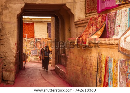 JAISALMER, INDIA - MARCH 2017: Tourists Wander the Street Market in Jaisalmer Fort, India