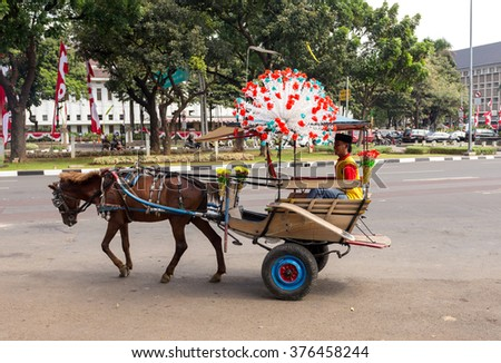 JAKARTA - August 10: Horse drawn carriage in the street of Jakarta. August 10, 2015 in Jakarta, Indonesia. - stock photo