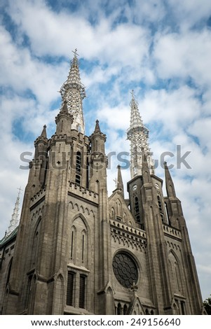 Jakarta cathedral with blue sky behind it - stock photo