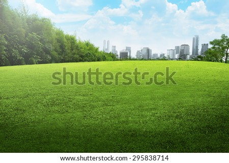 Jakarta city park with blue cloudy sky - stock photo