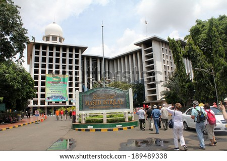 JAKARTA, INDONESIA-APRIL 6:  Tourists sightseeing outside the Masjid Istiqlal , the largest mosque in Southeast Asia with a capacity of 120,000 and located in Indonesia's capital  on April 6, 2014. - stock photo