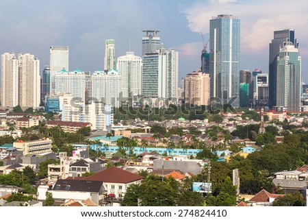 Jakarta, Indonesia capital city, is a mixed of modern buildings with villages like housing structure right in the center of the city - stock photo