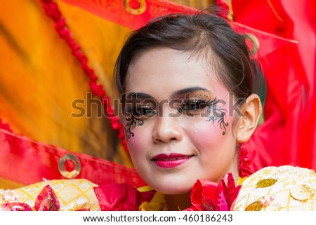 Jakarta, Indonesia - December 17, 2011: Attractive carnival model from Jember Fashion Carnaval posing and dancing during the opening ceremony of a new mall in Kuningan business district, Jakarta.