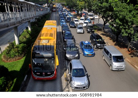 Jakarta, Indonesia - February 24, 2015: Transjakarta bus was passing in a special way in Sudirman street, Jakarta, Indonesia