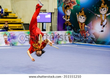 JAKARTA, INDONESIA - NOVEMBER 17, 2015: Ami Li of the USA performs the movements in the women's Gunshu event at the 13th World Wushu Championship 2015 in Istora Senayan Stadium.