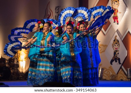 JAKARTA, INDONESIA: NOVEMBER 13, 2015: Dancers perform a traditional Javanese fan dance at the opening ceremony of the 13th World Wushu Championship 2015 in Jakarta Convention Centre.