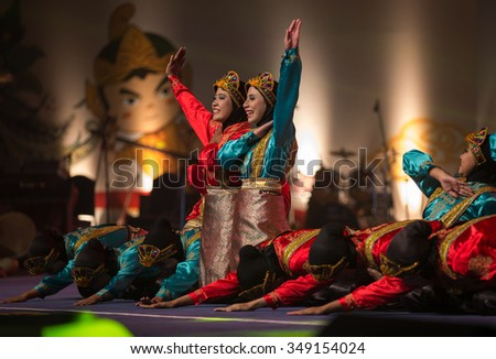 JAKARTA, INDONESIA: NOVEMBER 13, 2015: Dancers perform traditional Indonesia dances at the opening ceremony of the 13th World Wushu Championship 2015 in Jakarta Convention Centre. - stock photo