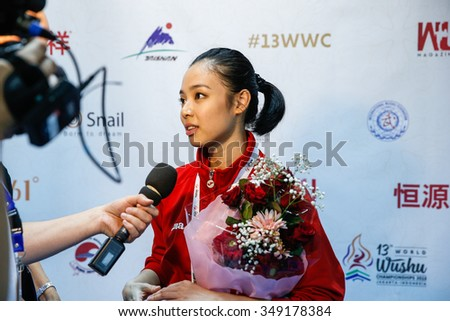 JAKARTA, INDONESIA - NOVEMBER 14, 2015: Lindswell Kwok from Indonesia speaks to Wushu TV after winning the gold in the women's Taijiquan event in the 13th World Wushu Championship 2015. - stock photo