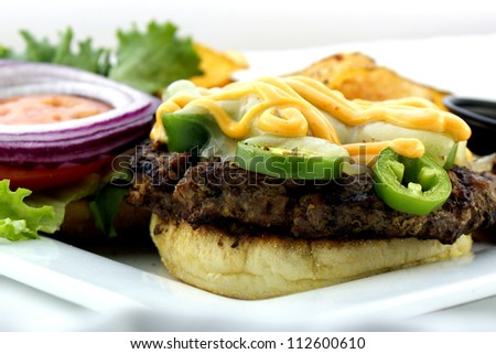 Jalapeno Burger topped with spicy Aioli. - stock photo