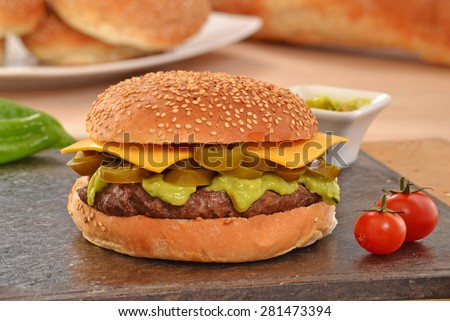 Jalapenos rustic cheese burger and avocado sauce. - stock photo