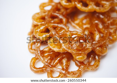 Jalebi - funnel cake a popular south asian sweet dish. - stock photo